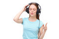 Young woman with headphones listening to music and dancing isolated Stock Photos
