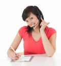 Young woman in headset from call center smiling Royalty Free Stock Photography