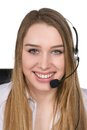 Young woman with headset cut out image of a smiling a who is sitting at the desk Royalty Free Stock Photo
