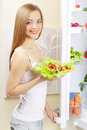 Young woman with healthy salad Royalty Free Stock Photo