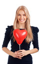 Young woman with heart shape balloons Royalty Free Stock Images