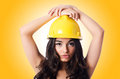 Young woman with hellow hard hat Royalty Free Stock Photo