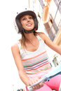 Young woman with helmet riding scooter portrait of motorcycle in town Stock Photography