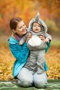 Young woman and her baby boy dressed in costume Royalty Free Stock Photo
