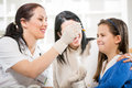 Young woman and her daughter at the doctor homeopaths Royalty Free Stock Photo
