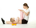 Young woman and her daughter doing sport exercises Royalty Free Stock Photo