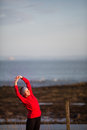Young woman on her evening jog along the seacoast Royalty Free Stock Photo
