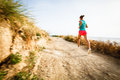 Young woman on her evening jog along the seacoast Stock Photography