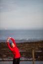 Young woman on her evening jog along the seacoast Stock Photos