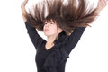 Young woman with her hair flying in the air long straight brunette and arms raised above head isolated on white Stock Image