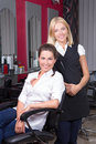 Young woman and her hairdresser at barbershop beautiful women Royalty Free Stock Images