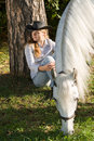 Young woman with her horse Stock Photography