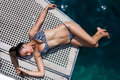 Young woman on her private yacht in bikini deck Stock Photo