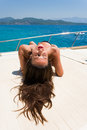 Young woman on her private yacht suntanning Stock Photo