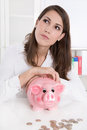 Young woman with her savings is dreaming of her next holiday teenager a better future which more money Stock Images