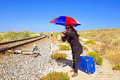 Young woman with her suitcase waiting at a railroad track traveler Royalty Free Stock Photos