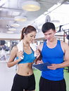 Young woman and her trainer women talking to about training plan Royalty Free Stock Photos