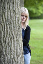 Young woman hiding behind a tree beautiful Royalty Free Stock Images