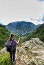 Young woman hiker admiring the beautiful mountain Royalty Free Stock Photo