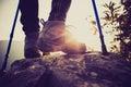 Young woman hiker legs climbing at mountain peak Royalty Free Stock Photo