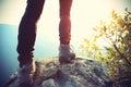 Young woman hiker legs on sunrise mountain peak Royalty Free Stock Photo