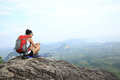Young woman hiker taking photo with smart phone Royalty Free Stock Photo