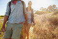 Young woman hiking in mountain with her boyfriend image of women mountains front couple walking downhill on summer vacation Stock Photography
