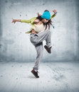 Young woman hip hop dancer grunge wall background texture Royalty Free Stock Photo