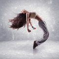 Young woman hip hop dancer grunge wall background texture Stock Images
