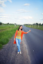 Young woman hitch-hiking Stock Image