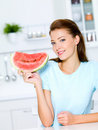 Young woman hold a red water-melon Stock Photos
