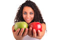 Young woman holding apple. Isolated over white Stock Photo
