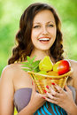 Young woman holding a basket Royalty Free Stock Photography