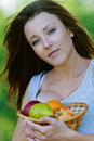 Young woman holding basket Royalty Free Stock Photography