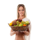 A young woman holding a basket full of fruits Royalty Free Stock Photography