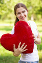 Young woman holding big red heart Royalty Free Stock Photo