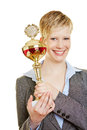 Young woman holding big trophy cup a Stock Photos