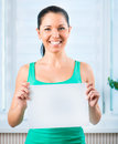 Young woman holding a blank portrait of happy casual signboard horizontally Stock Photography