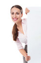 Young woman holding blank poster over white background Royalty Free Stock Photos