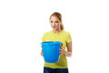 Young woman holding blue bucket. Royalty Free Stock Photo