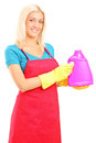 Young woman holding a bottle of cleaning solution isolated on white background Royalty Free Stock Photo