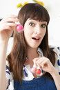 Young Woman Holding Bottles Of Colorful Nail Polish Royalty Free Stock Photo