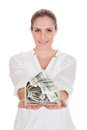 Young woman holding a box of currency over white background Royalty Free Stock Photography