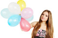 Young woman holding bunch balloons Royalty Free Stock Photography