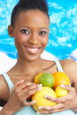 Young Woman Holding Citrus Fruit In Studio Stock Images