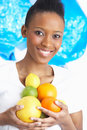 Young Woman Holding Citrus Fruit In Studio Royalty Free Stock Images