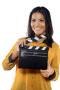 Young woman holding clapperboard isolated over white background Royalty Free Stock Photos