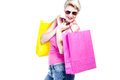 Young woman holding colored shopping bags isolated on white Stock Photography