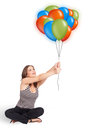 Young woman holding colorful balloons Royalty Free Stock Photography