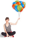 Young woman holding colorful balloons beautiful Royalty Free Stock Photos